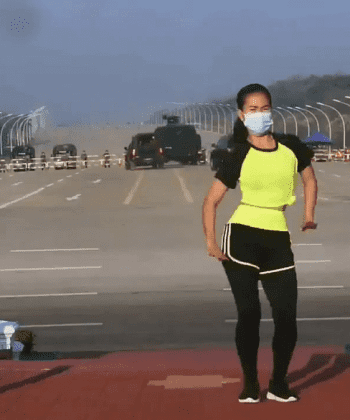 Myanmar Aerobic Instructor Performs her Workout Routine with a Coup Behind Her
